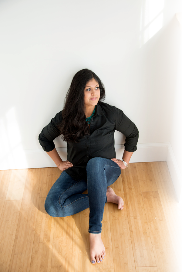 Amisha Patel Sitting on floor looking away
