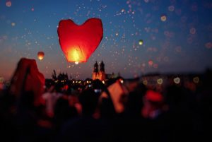 Red heart lantern lit and released into the sky